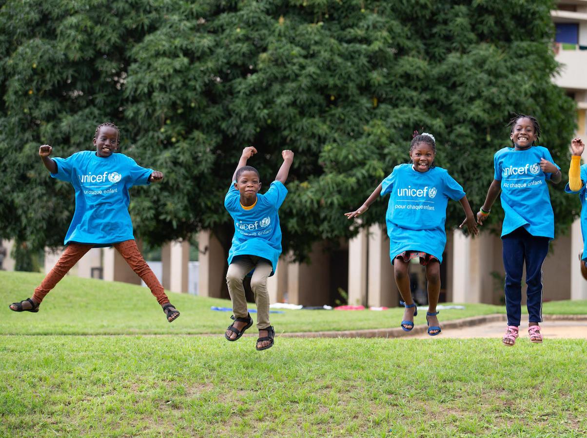 Koumba, Jean Uriel, Mariam and Yasmine jump for joy before World Children's Day 2020 in Abidjan, Côte d'Ivoire.