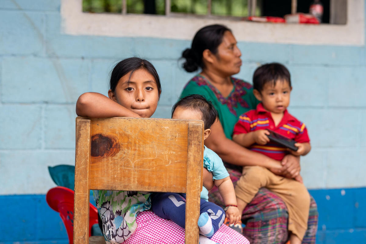 Juana, 9, photographed with her mother and siblings at a shelter in Campur, San Pedro Carchá, Alta Verapaz, Guatemala.