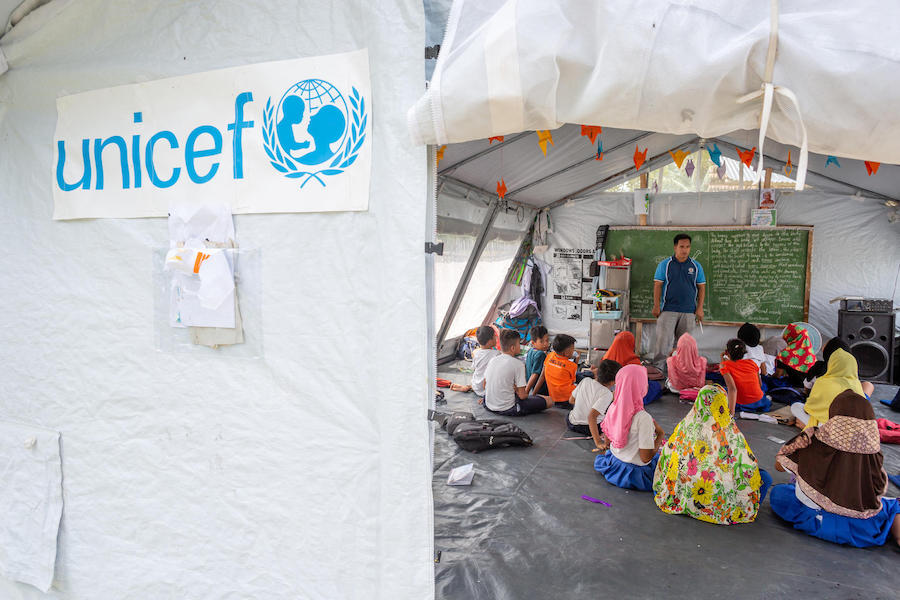 On September 16, 2019, in Maguindanao, Mindanao, the Philippines, children learn in a new high-performance UNICEF tent that makes up part of Kulasi Elementary School.