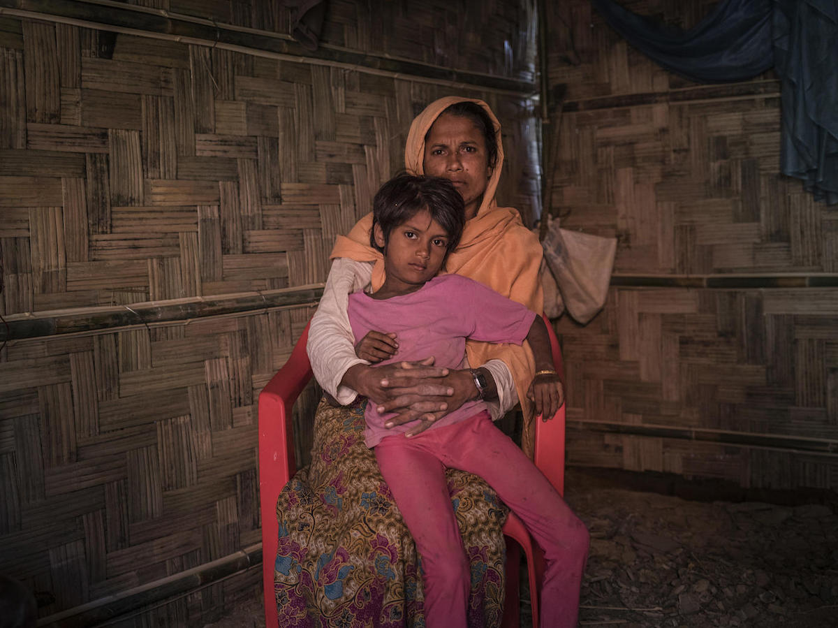 On 2 December 2019, Anjuma Bengum, 30, holds her daughter Lala Bibi, 5, at their home in Balukhali refugee camp in Cox's Bazar, Bangladesh. Anjuma's second daughter, Asma, 9, disappeared while on her way to buy groceries in the market.