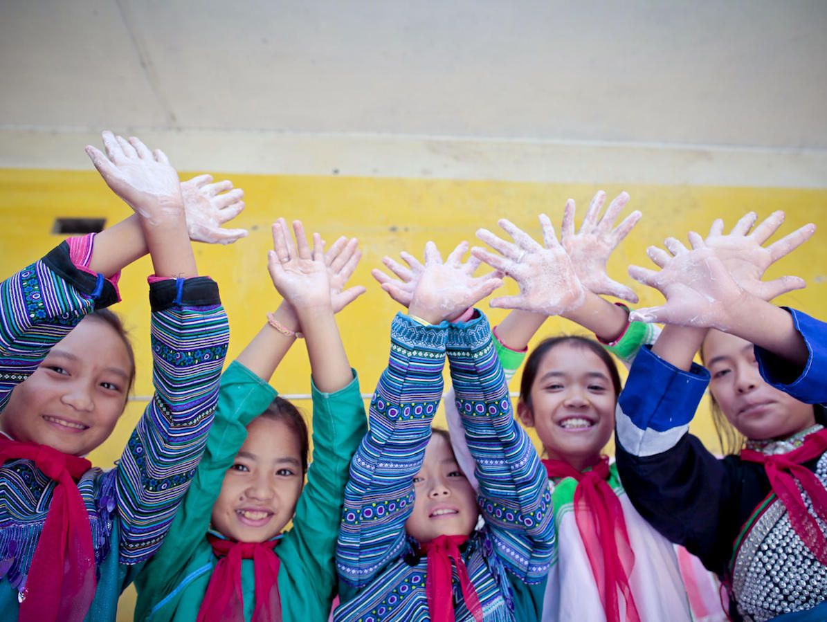 Children from the UNICEF-supported Muong Khuong Boarding School in Lao Cai, Vietnam enjoy washing their hands with soap and clean water.