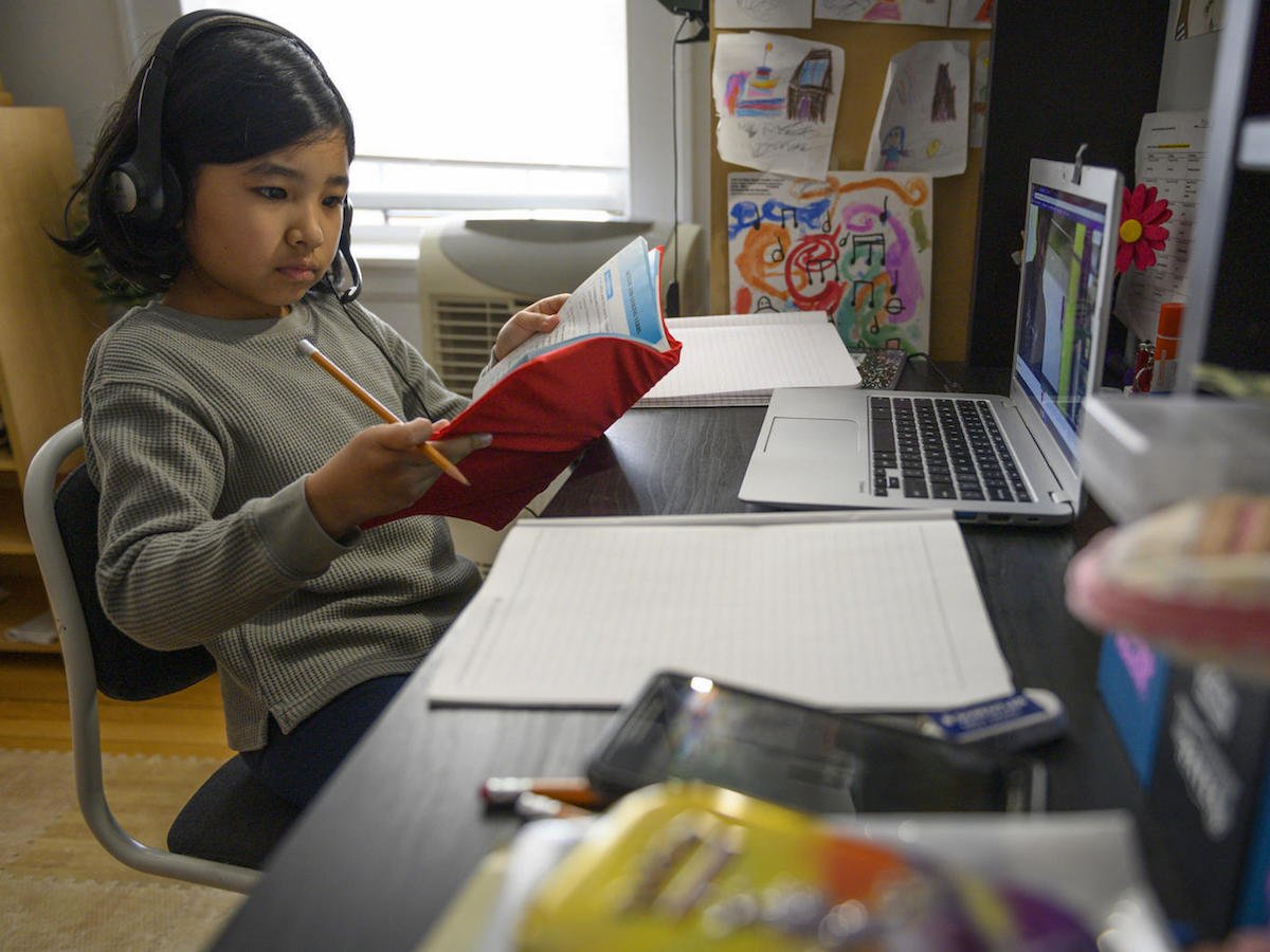 On 2 April 2020, Yolanda, 9, participates in one of her first virtual classes while studying from home in New York City, United States of America.