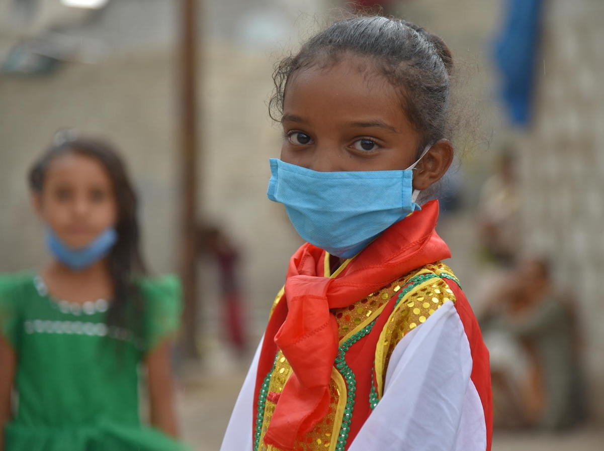 Seven-year-old Jabra wears a mask to prevent transmission of the novel coronavirus in Yemen in 2020.