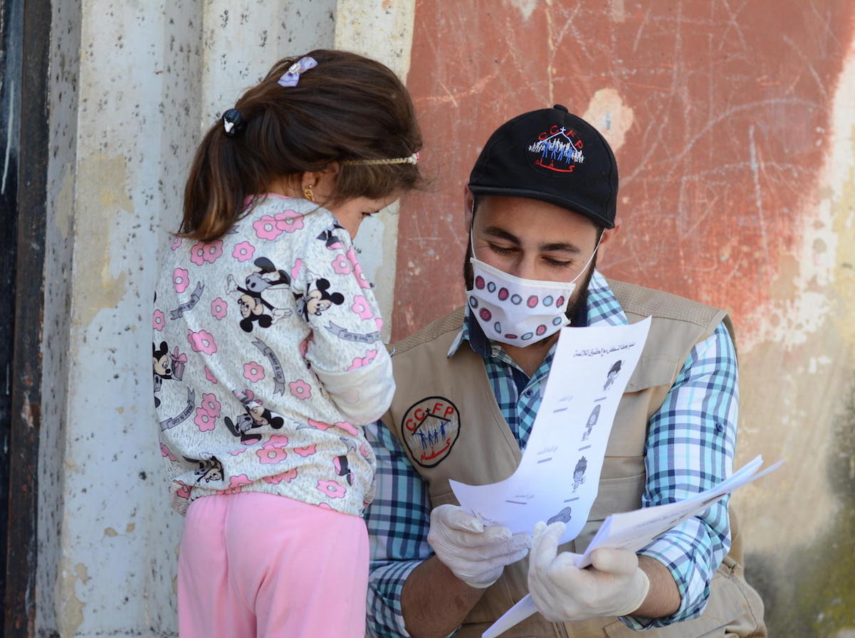 On May 14, 2020, UNICEF-supported volunteer Osama goes door-to-door providing educational activities and COVID-19 prevention information for out-of-school children in northern rural Homs, Syria.