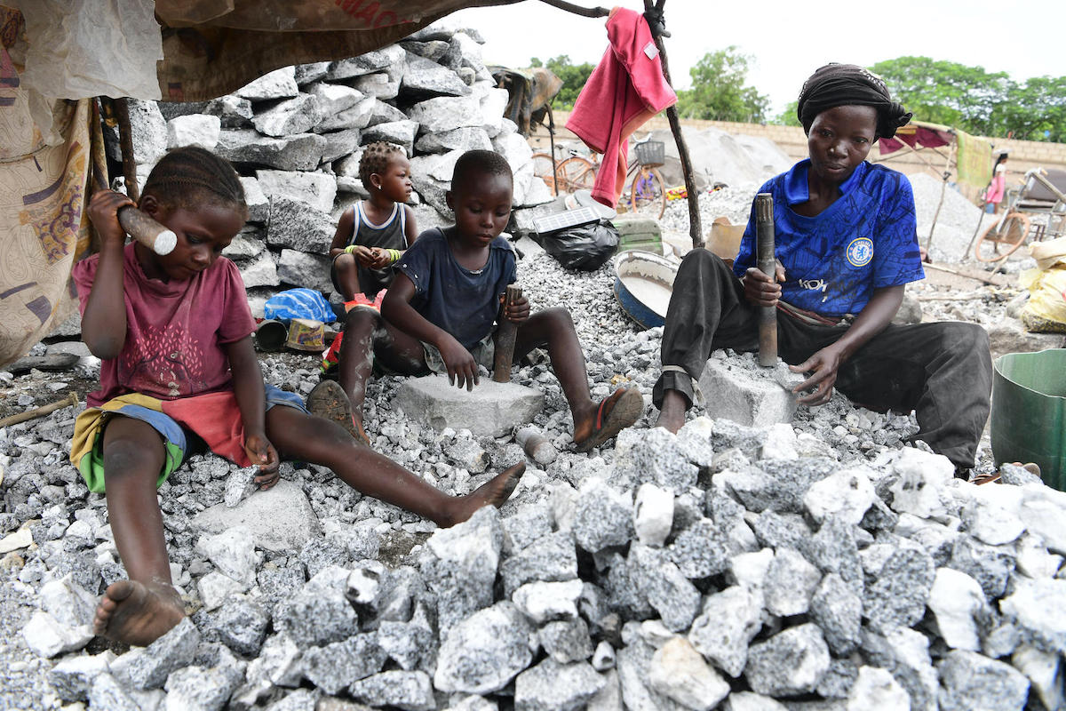 Children and parents often work side by side in the mines in Burkina Faso.