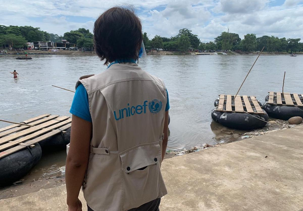A member of UNICEF's staff stands by the Suchiate River at the Mexico-Guatemala border, a popular crossing point along the migration route.