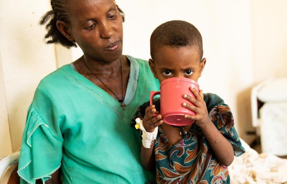 A child suffering from acute malnutrition drinks therapeutic milk provided by UNICEF as part of the ongoing humanitarian response in Ethiopia's Tigray region.