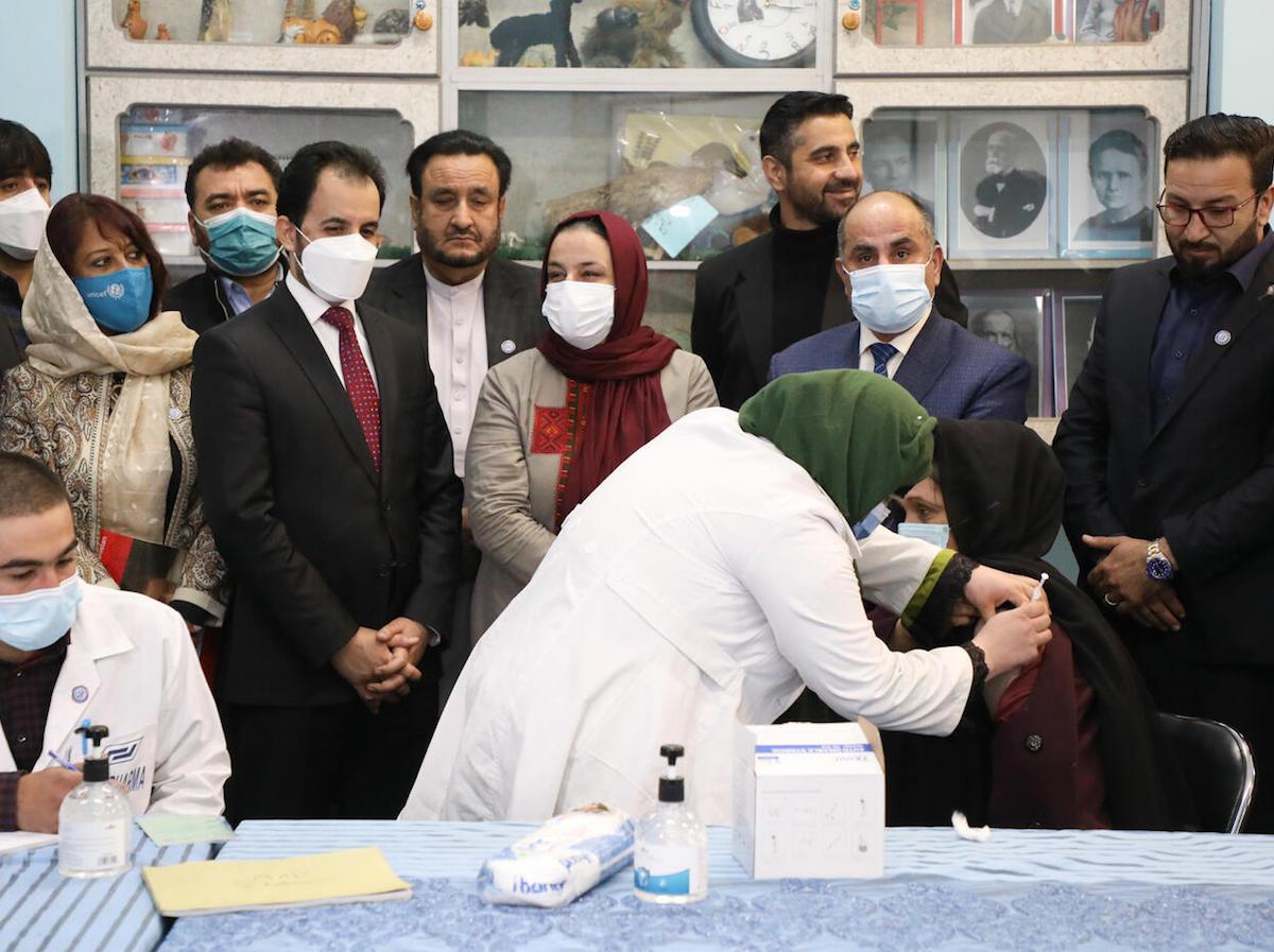 Ms. Palwasha Rafi Najemi, 40, principal of the Khwajah Rawash Girls High School receives the COVAX-facilitated COVID-19 vaccine at the Al-Fateh girls' high school in Kabul, Afghanistan.