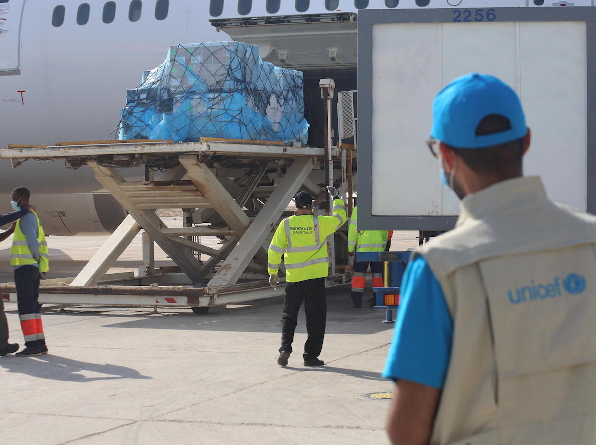 A UNICEF staff member works with partners to facilitate the delivery of a new shipment of 31,200 additional doses of Covid-19 vaccine on April 26, 2021 to Nouakchott International Airport in Mauritania as part of the COVAX initiative.