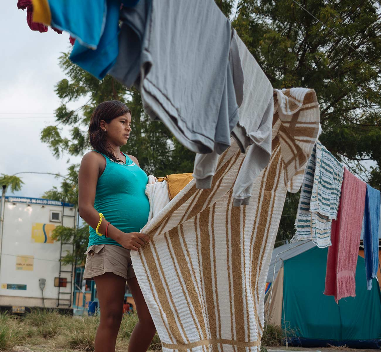 A pregnant ecuadorian woman worries what the fate of her unborn baby will be. Donation Form Background