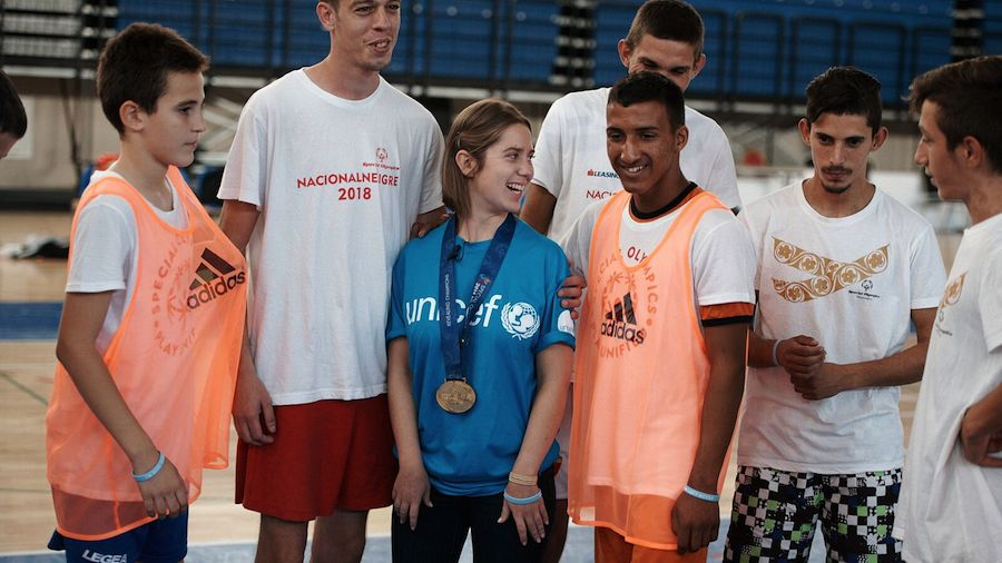 Lucy Meyer, an advocate for children with disabilities, visiting with Special Olympics youth athletes in Montenegro.