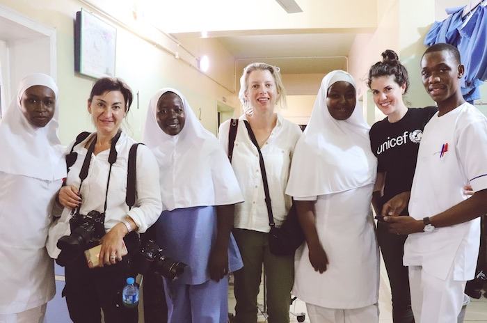 Erica Vogel of UNICEF USA with Lynsey Addario and Aryn Baker from TIME posing with health workers in Borno State, Nigeria.