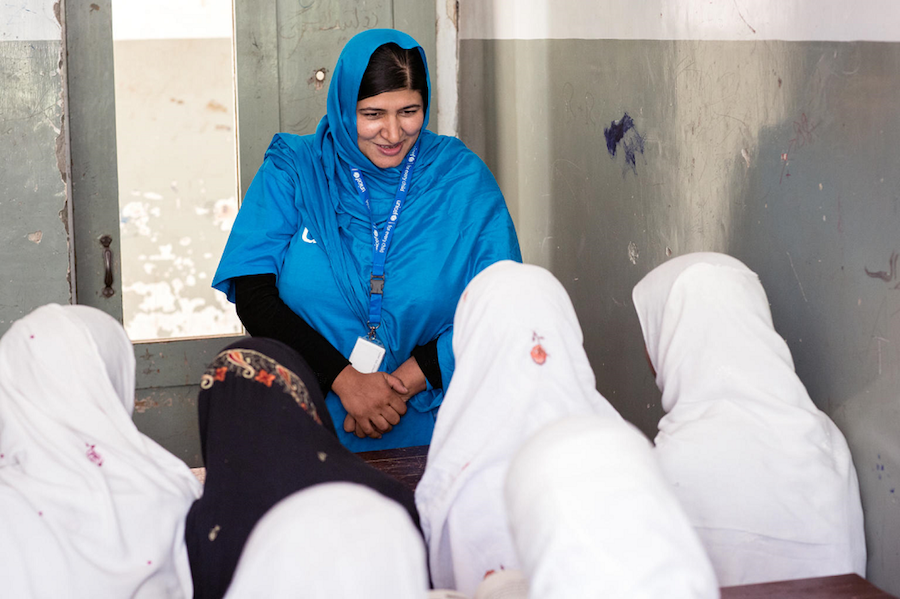 UNICEF Education Specialist Anita Haidary meets with students at a UNICEF-supported school in Nangarhar, Afghanistan in 2019.