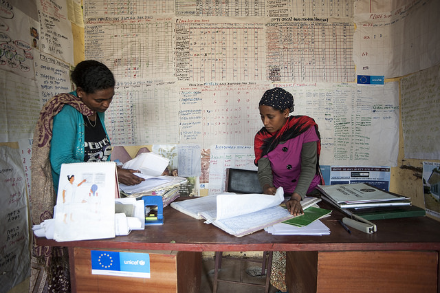 Two health extension workers prepare their monthly report on nutrition activities in their district. ©UNICEF Ethiopia/2014/Tsegaye.