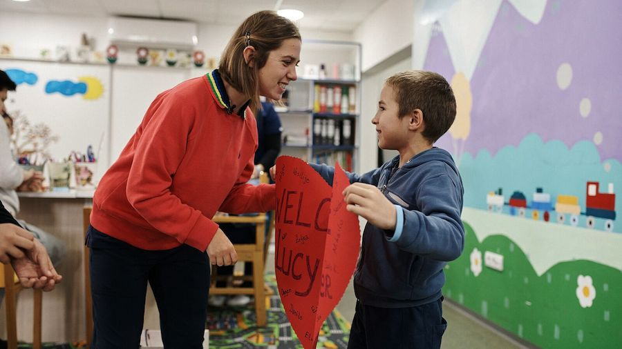 Lucy Meyer, spokesperson for the UNICEF-Special Olympics partnership, receives a warm welcome from a student during her visit to a school in Montenegro.