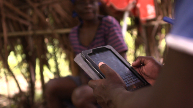 Data collected at community level is captured using locally-made tablets. (c) UNICEF Haiti/2014/Nybo
