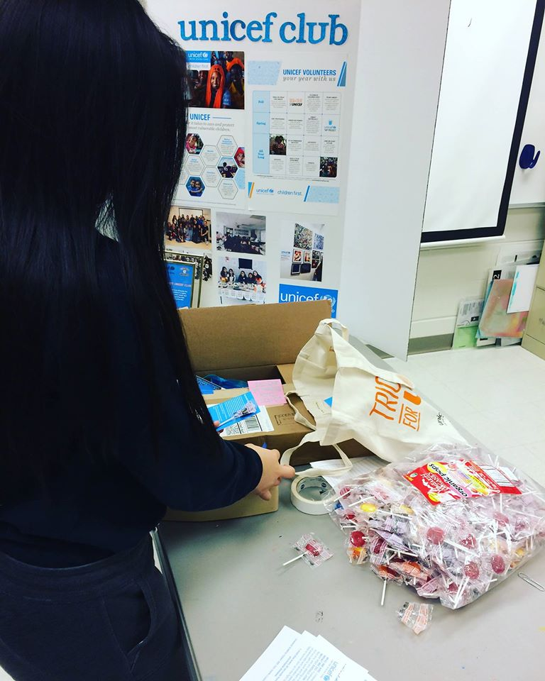 Niles West students unpack fair trade suckers to highlight fair trade goods