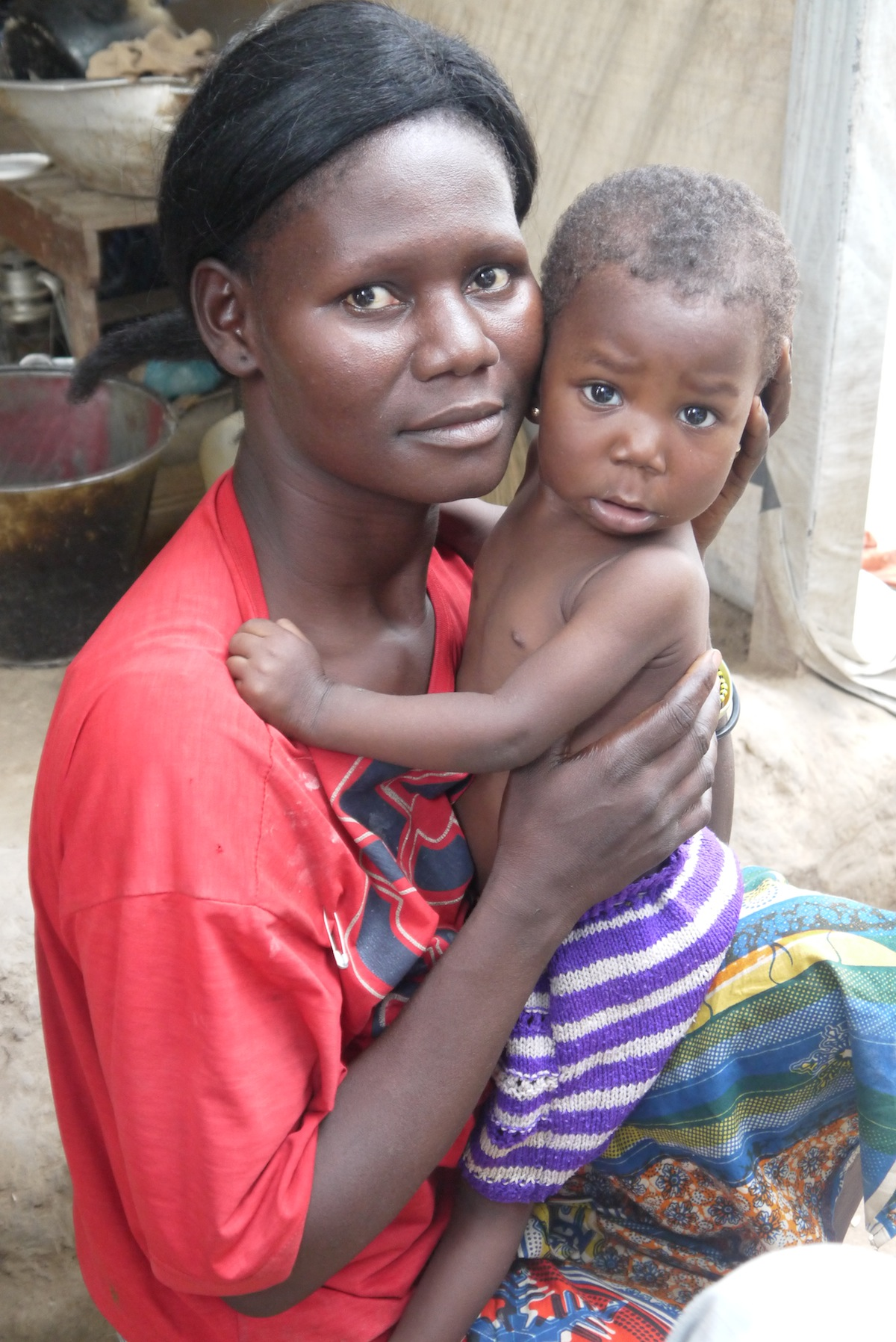 A mother and child just after getting the child's birth registered in the Central African Republic.