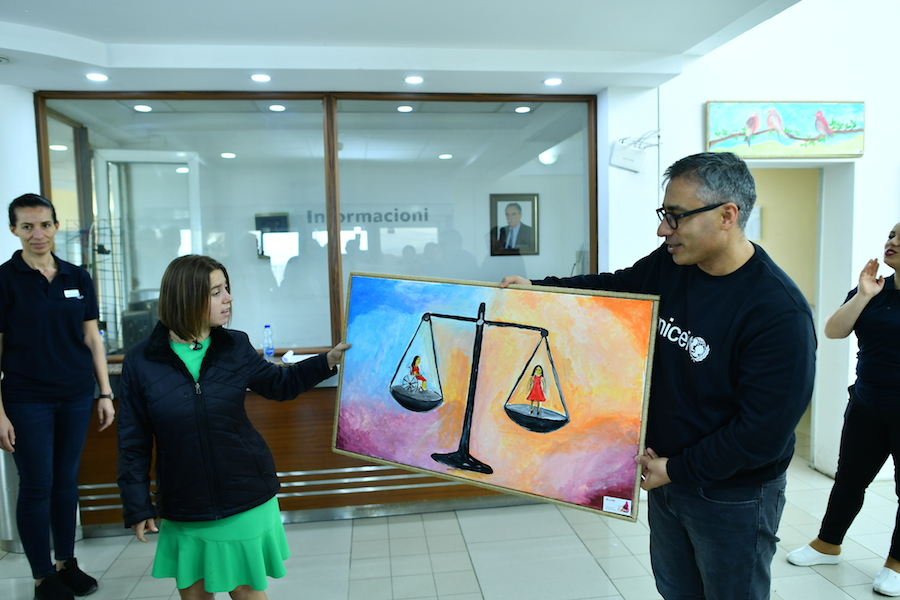 Lucy Meyer is given a painting as a thank you for her efforts on behalf of children with disabilities.
