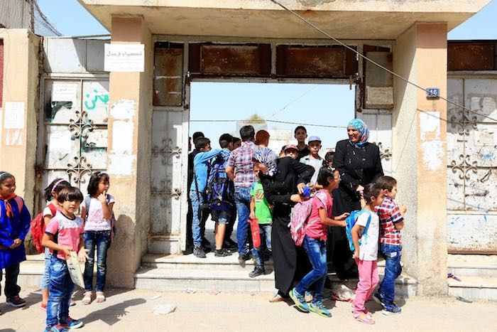 Mothers picking up their children from a school in Homs.