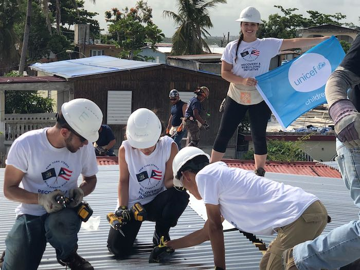SUNY and CUNY students are replacing and reinforcing roofs on homes damaged during Hurricane Maria as part of a UNICEF USA supported recovery effort in partnership with New York State.