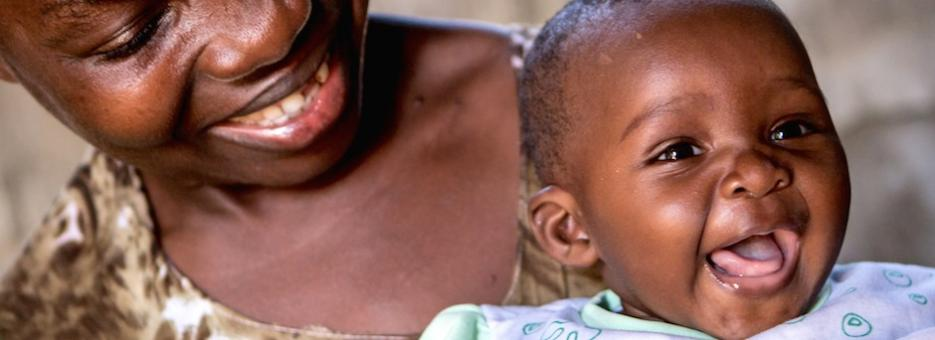 A mother holds a healthy baby: One more success in the fight against HIV/AIDS.