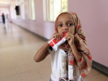 A girl in Sa'ana, Yemen is given Ready-to-Use Therapeutic Food (RUTF), a high-protein peanut paste, as treatment for malnutrition.