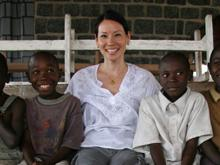 UNICEF National Ambassador for the United States Lucy Liu sits smiling with a group of children at a UNICEF-supported youth centre at a hospital in the eastern town of Goma in the Democratic Republic of Congo