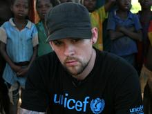 UNICEF National Ambassador for the United States Joel Madden attends a discussion with community members and health workers on the impact of HIV/AIDS on children in the Central African Republic