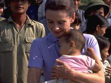Audrey Hepburn is accompanied by children on a walk in the hamlet of Phuc Ly, Phu Minh Commune, Tu Liem District near Hanoi.