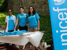 Georgetown University volunteers stand at a table prepared for the event.