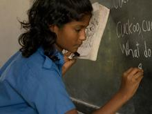 Chinu Rajbongshi 11, writing a poem on the board. Kusura Govt. Primary School, Kalampur, Bangladesh. Nov. 19 2008