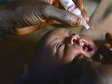 World Polio Day 2015. A infant in Nigeria is immunized against polio during a UNICEF-supported vaccination drive in March,2015.