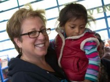 U.S. Fund for UNICEF CEO Caryl Stern holding a child in Guatemala