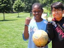 David and Ibrahim show off their UNICEF Kid Power Bands during Lexington Academy's Field Day in Central Park's East Meadow.