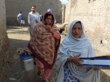 """UNICEF-supported """"lady health workers"""" Jameela, right, and Shamul visit the village of Peer Jo Goth in Pakistan's Kambar District to vaccinate women of childbearing age against tetanus."""