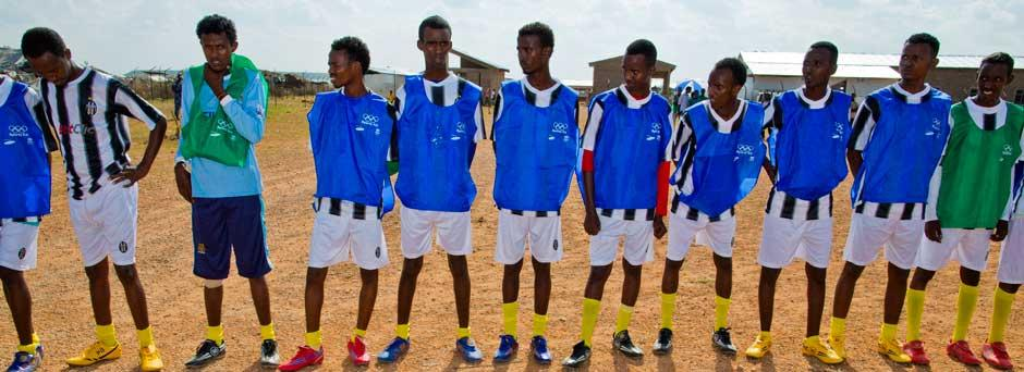 Members of Melkadida refugee camp football team wait for the kickoff of the inter-camp game after the official ceremony celebrating the donation of sports kits by the International Olympic Committee (IOC)
