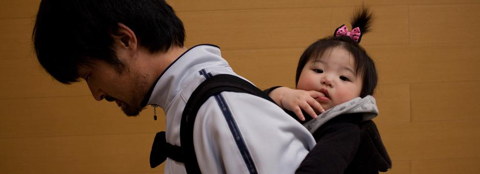 On 13 March, a man carries his daughter in an emergency evacuation centre for people affected by the earthquake and subsequent tsunami, in the city of Koriyama, in Fukushima Prefecture.