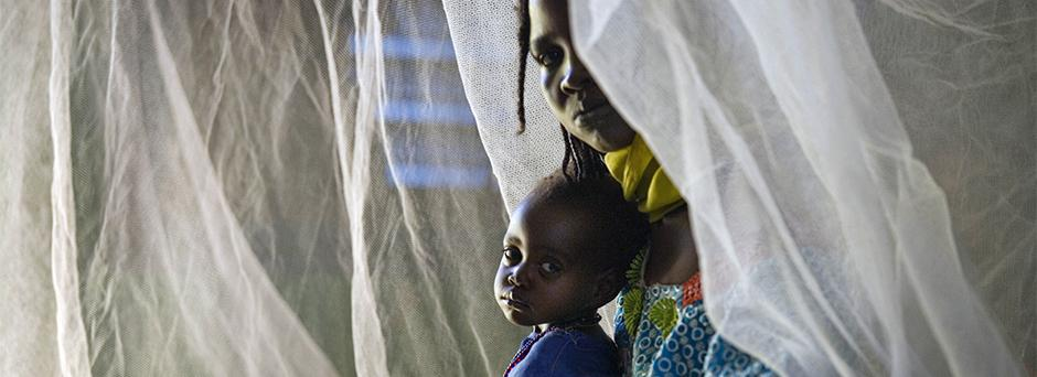 On 2 March, a woman and her child, refugees from Sudan's Darfur Region, sit on a bed in a UNICEF-supported therapeutic feeding centre in the eastern town of Goz Beïda, Ouaddaï Region.