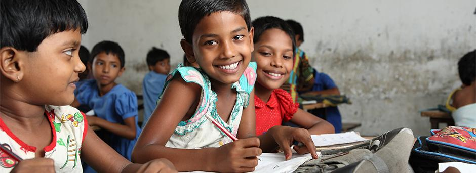Students from the first grade work on their Mathematics skills at Bairy Harin Mary Government Primary School at Palashbari, Gaibandha on 5 September 2013.