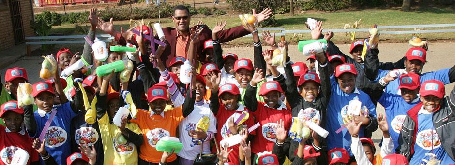 UNICEF Ambassador Laurence Fishburne spends time with children during his UNICEF field visit to South Africa in 2004.