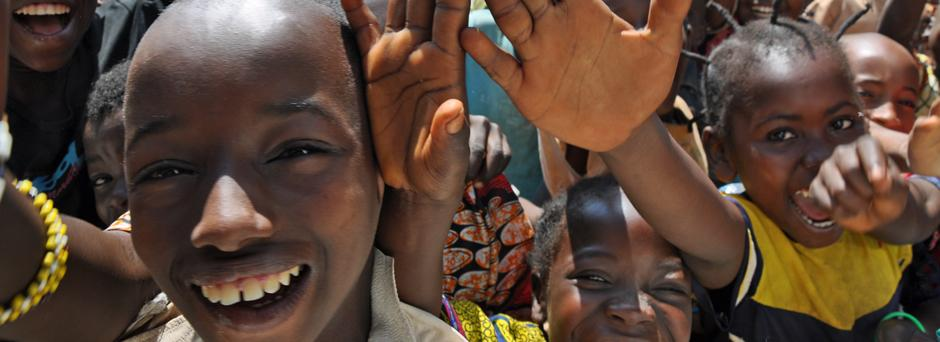 Children rush towards the camera smiling in the Central African Republic where seven schools have been built by UNICEF and NGO partners.