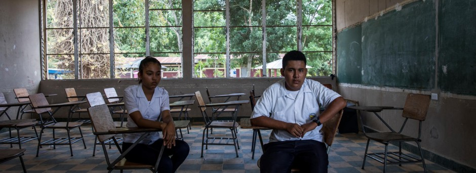 On 31 August 2018 in Villanueva, Honduras, Josseline Rodriguez (left), 17, and Darwin Martinez, 16, sit in the classroom that they shared with their friend Henry. Henry committed suicide in September of 2016.