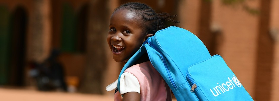 UNICEF provides backpacks and learning materials to school children around the world, including this student in Niamey, Niger.