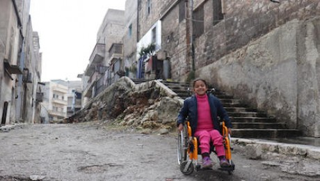 Hanaa, 8, was paralyzed when a bomb exploded in East Aleppo, Syria. For months afterward, she was afraid to leave her house, until volunteers encouraged her to visit a UNICEF-supported Child-Friendly Space where she can play, sing and draw.