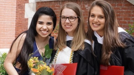 UNICEF USA Community Engagement Fellow Giovana Ortiz-Barrera, left, and classmates celebrate their graduation from Clark University in 2017.