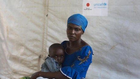 Zuliya Nboyo holds her 2-year-old son, Kayoka, while they wait to see a UNICEF-supported community health worker at an Internally Displaced Persons camp in Kalemi, Tanganyika province, Democratic Republic of Congo in November 2018.