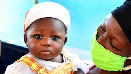 A mother and her baby at the UNICEF-supported Primature health center of San Pedro in southwest Côte d'Ivoire on May 14, 2020.