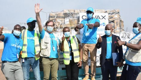 UNICEF staff cheering at Juba International Airport on March 25, 2021 after the arrival of the first batch of COVID-19 vaccines in South Sudan through the COVAX Facility.
