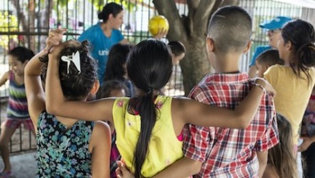 Kids play at a UNICEF-supported Child-Friendly Space at a migrant shelter in Mexico.